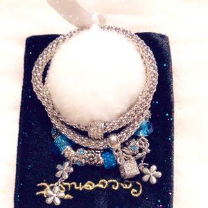 Jewelry - Three piece charm bracelet set